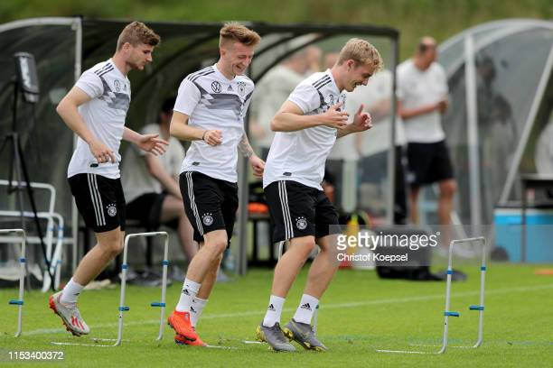 Timo Werner Marco Reus and Julian Brandt of Germany during a training session ahead of their UEFA European Championship Qualifier match against...
