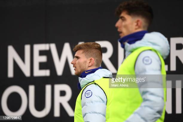 Timo Werner of Chelsea and Kai Havertz of Chelsea look on as they warm up during the Premier League match between Fulham and Chelsea at Craven...