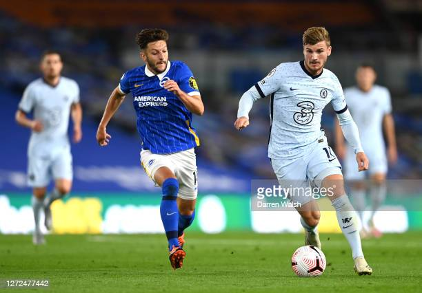 Timo Werner of Chelsea battles for possession with Adam Lallana of Brighton and Hove Albion during the Premier League match between Brighton Hove...
