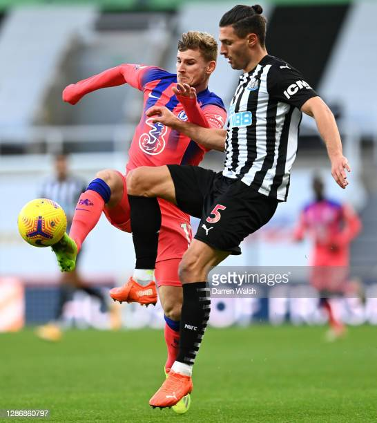 Timo Werner of Chelsea battles for possession with Fabian Schaer of Newcastle United during the Premier League match between Newcastle United and...