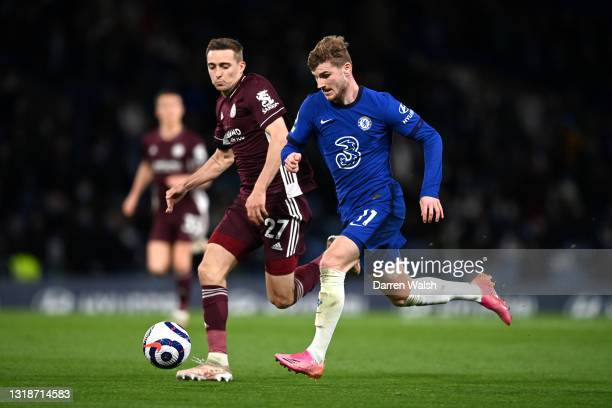 Timo Werner of Chelsea battles for possession with Timothy Castagne of Leicester City during the Premier League match between Chelsea and Leicester...