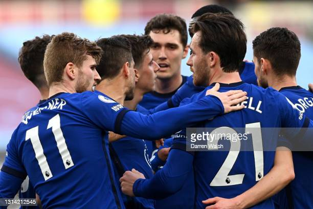 Timo Werner of Chelsea celebrates after scoring their sides first goal with team mate Ben Chillwell and team mates during the Premier League match...