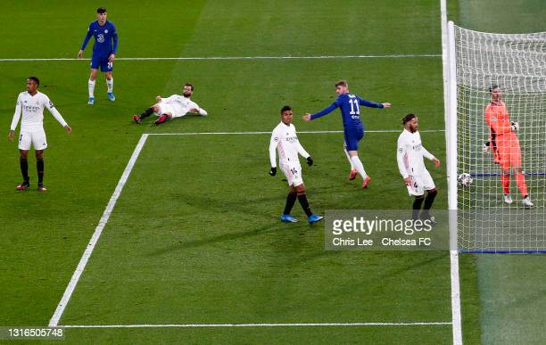 Timo Werner of Chelsea celebrates after scoring their team's first goal as Casemiro, Thibaut Courtois and Sergio Ramos of Real Madrid look dejected...
