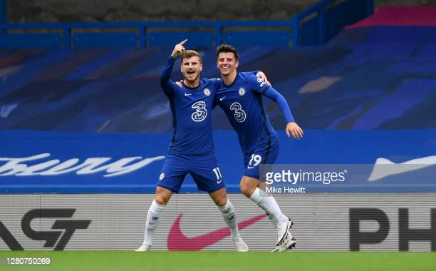 Timo Werner of Chelsea celebrates with teammate Mason Mount after scoring his sides second goal during the Premier League match between Chelsea and...