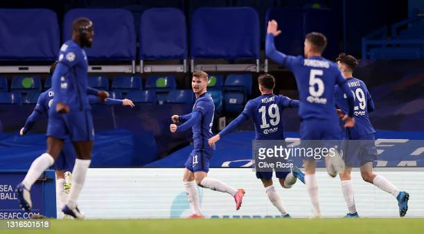 Timo Werner of Chelsea celebrates with teammates after scoring their team's first goal during the UEFA Champions League Semi Final Second Leg match...
