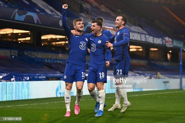 Timo Werner of Chelsea celebrates with teammates Mason Mount, Kai Havertz and Ben Chilwell after scoring their team's first goal during the UEFA...