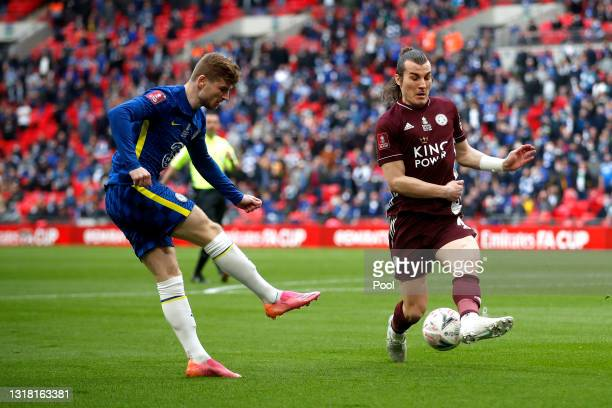 Timo Werner of Chelsea crosses the ball which is blocked by Caglar Soyuncu of Leicester City during The Emirates FA Cup Final match between Chelsea...