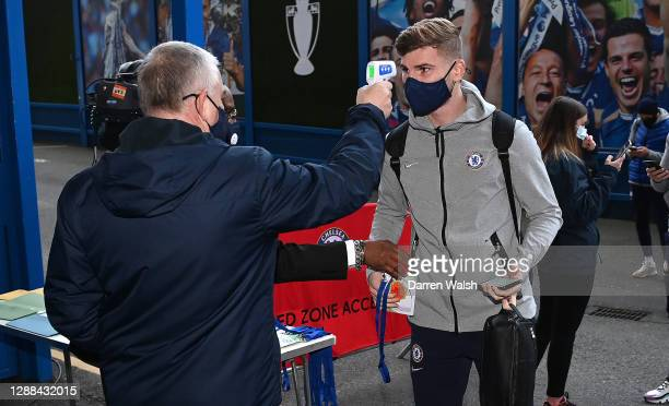 Timo Werner of Chelsea has his temperature checked before entering the stadium prior to the Premier League match between Chelsea and Tottenham...