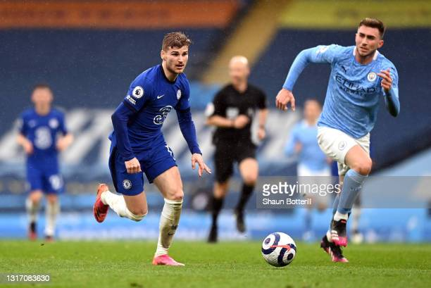 Timo Werner of Chelsea is breaks away from Aymeric Laporte of Manchester City during the Premier League match between Manchester City and Chelsea at...