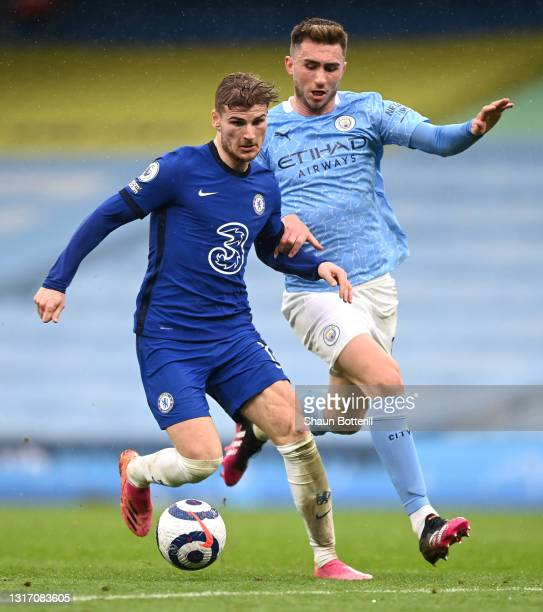 Timo Werner of Chelsea is challenged by Aymeric Laporte of Manchester City during the Premier League match between Manchester City and Chelsea at...