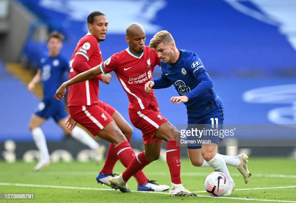 Timo Werner of Chelsea is challenged by Fabinho of Liverpool during the Premier League match between Chelsea and Liverpool at Stamford Bridge on...