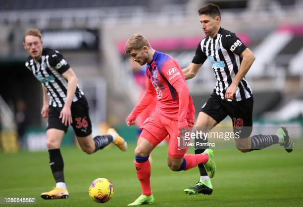 Timo Werner of Chelsea is challenged by Federico Fernandez of Newcastle United during the Premier League match between Newcastle United and Chelsea...