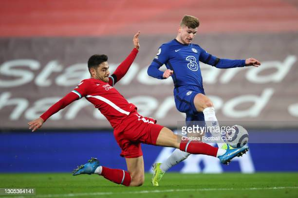 Timo Werner of Chelsea is challenged by Ozan Kabak of Liverpool as he scores a goal which is disallowed following a VAR review during the Premier...