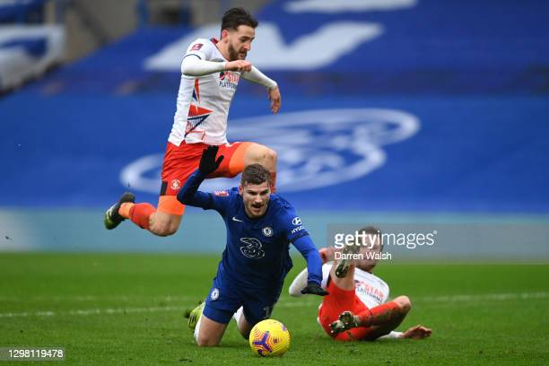 Timo Werner of Chelsea is tackled by Jordan Clark of Luton Town leading to a penalty during The Emirates FA Cup Fourth Round match between Chelsea...