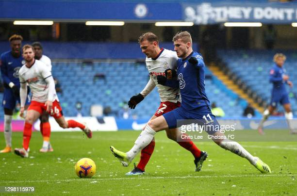 Timo Werner of Chelsea looks to break past Kiernan Dewsbury-Hall of Luton Town during The Emirates FA Cup Fourth Round match between Chelsea and...