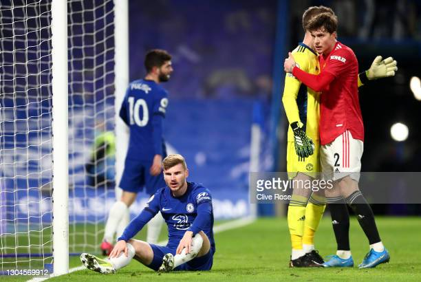Timo Werner of Chelsea reacts after missing a chance as David De Gea of Manchester United congratulates team mate Victor Lindelof during the Premier...