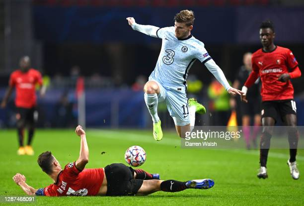 Timo Werner of Chelsea rides a tackle from Damien Da Silva of Stade Rennais FC during the UEFA Champions League Group E stage match between Stade...