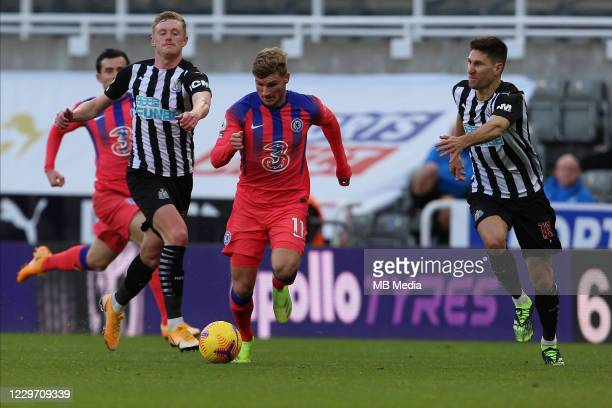 Timo Werner of Chelsea runs away from Federico Fernández of Newcastle during the Premier League match between Newcastle United and Chelsea at St...