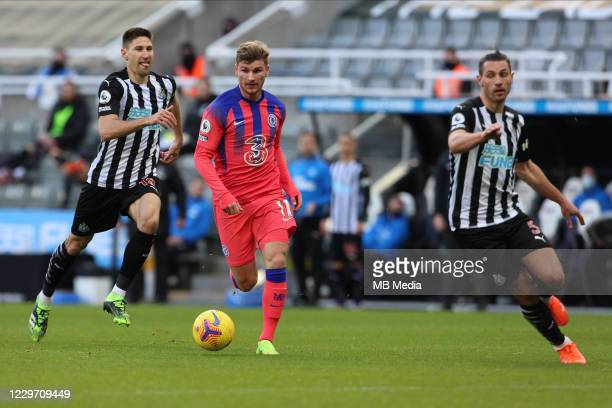 Timo Werner of Chelsea runs away from the Newcastle defenders during the Premier League match between Newcastle United and Chelsea at St James Park...