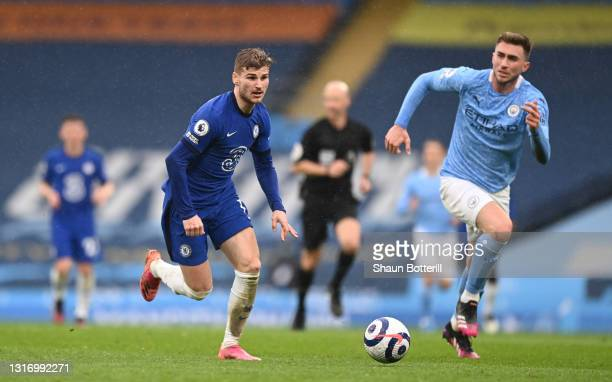 Timo Werner of Chelsea runs with the ball whilst under pressure from Aymeric Laporte of Manchester City during the Premier League match between...