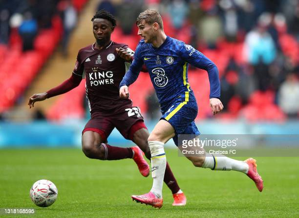 Timo Werner of Chelsea runs with the ball whilst under pressure from Wilfred Ndidi of Leicester City during The Emirates FA Cup Final match between...