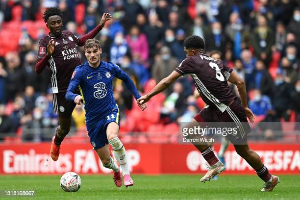 Timo Werner of Chelsea runs with the ball whilst under pressure from Wilfred Ndidi and Wesley Fofana of Leicester City during The Emirates FA Cup...