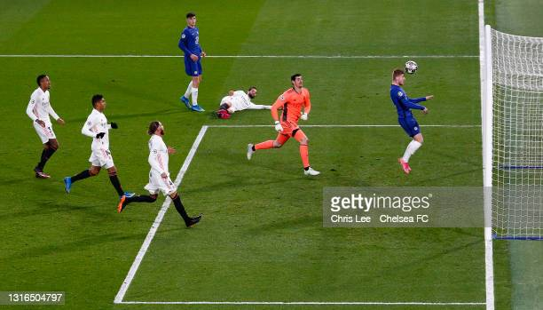 Timo Werner of Chelsea scores his team's first goal as Thibaut Courtois of Real Madrid looks on during the UEFA Champions League Semi Final Second...