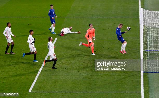 Timo Werner of Chelsea scores his team's first goal as Thibaut Courtois, Sergio Ramos, Nacho Fernandez, Casemiro and Eder Militao of Real Madrid look...