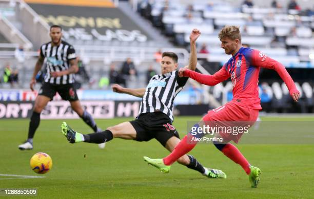 Timo Werner of Chelsea shoots under pressure from Federico Fernandez of Newcastle United during the Premier League match between Newcastle United and...