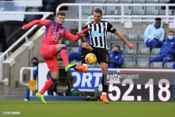 Timo Werner of Chelsea steals the ball from Fabian Schär of Newcastle during the Premier League match between Newcastle United and Chelsea at St...