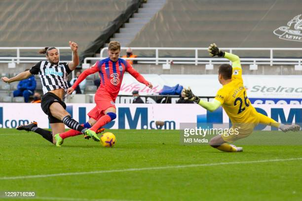 Timo Werner of Chelsea takes the ball around Andy Carroll of Newcastle and Karl Darlow of Newcastle but his effort is ruled offside during the...