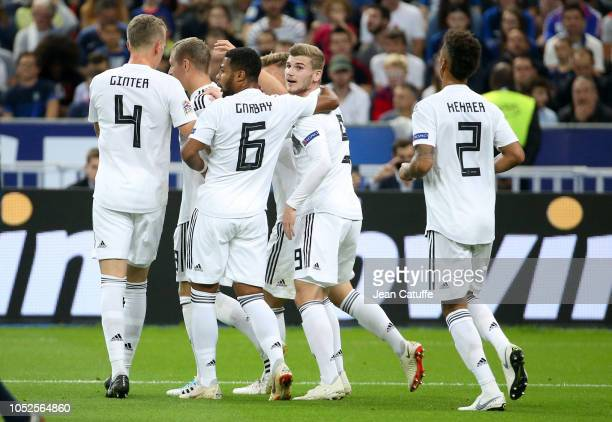 Timo Werner of Germany and teammates celebrate the goal of Toni Kroos during the UEFA Nations League A group one match between France and Germany at...