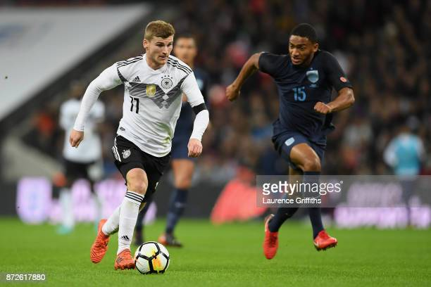 Timo Werner of Germany attempts to get past Joe Gomez of England during the International friendly match between England and Germany at Wembley...