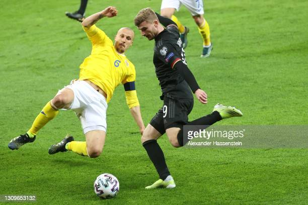 Timo Werner of Germany battles for the ball with Vlad Chririches of Romanie during the FIFA World Cup 2022 Qatar qualifying match between Romania and...