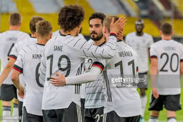 Timo Werner of Germany celebrates after scoring his team's sixth goal with teammates during the international friendly match between Germany and...