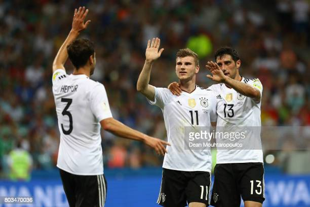 Timo Werner of Germany celebrates scoring his side's third goal with his team mates Jonas Hector and Lars Stindl of Germany during the FIFA...