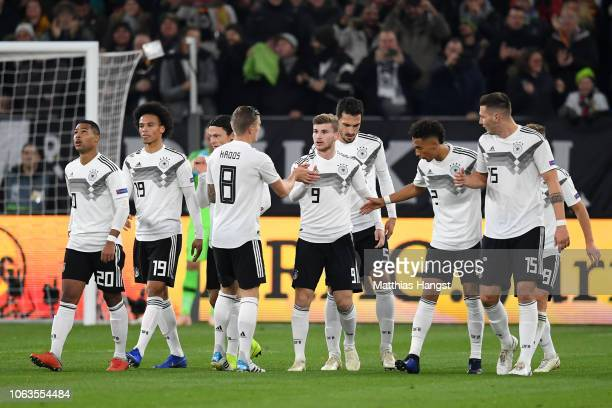 Timo Werner of Germany celebrates with his team mates after scoring his team's first goal during the UEFA Nations League A group one match between...