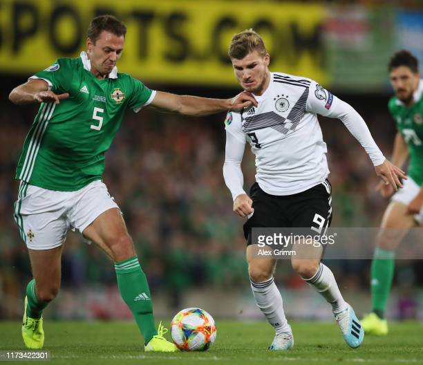 Timo Werner of Germany challenges for the ball with Jonny Evans of Northern Ireland during the UEFA Euro 2020 qualifier match between Northern...