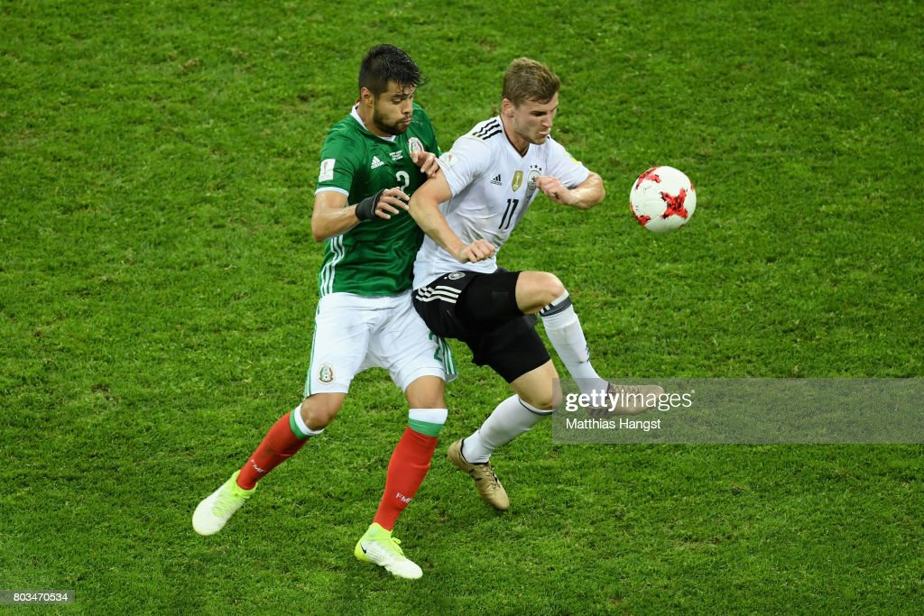 Timo Werner of Germany controls the ball under pressure of Nestor Araujo of Mexico during the FIFA Confederations Cup Russia 2017 Semi-Final between Germany and Mexico at Fisht Olympic Stadium on June 29, 2017 in Sochi, Russia.
