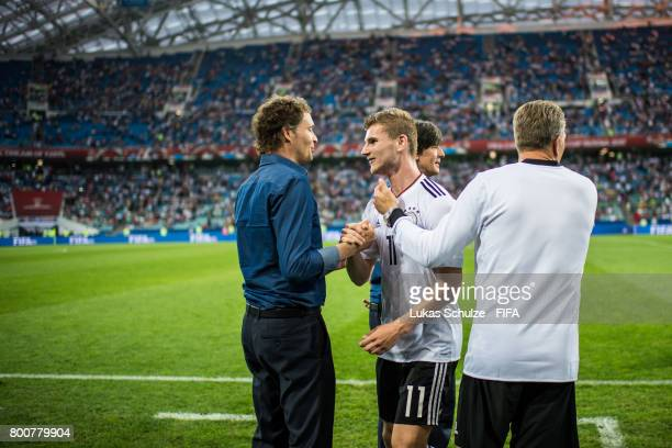 Timo Werner of Germany gets attention of Marcus Sorg and Andy Koepke after winning the FIFA Confederations Cup Group B match between Germany and...