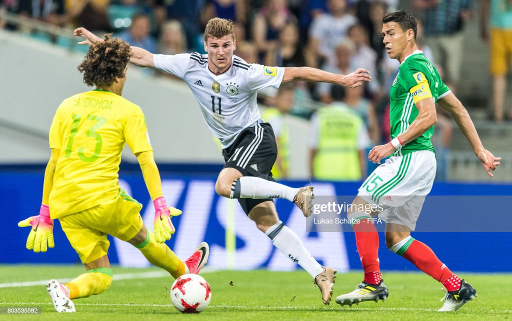 Timo Werner (C) of Germany, Goalkeeper Guillermo Ochoa (L) of Mexico and Hector Moreno (R) of Mexico fight for the ballduring the FIFA Confederations Cup Russia 2017 Semi-Final match between Germany and Mexico at Fisht Olympic Stadium on June 29, 2017 in Sochi, Russia.