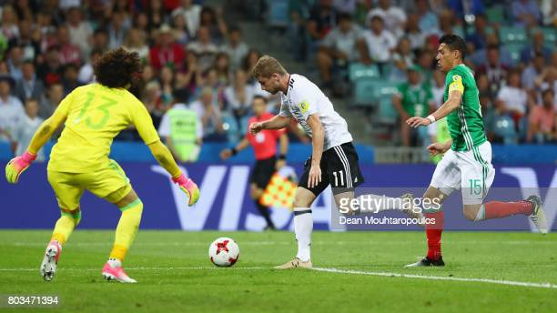 Timo Werner of Germany goes past Hector Moreno of Mexico to shoot during the FIFA Confederations Cup Russia 2017 SemiFinal between Germany and Mexico...
