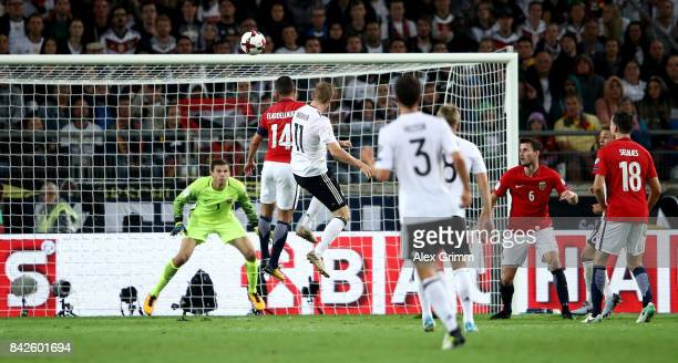 Timo Werner of Germany heads his teams fourth goal during the FIFA 2018 World Cup Qualifier between Germany and Norway at MercedesBenz Arena on...