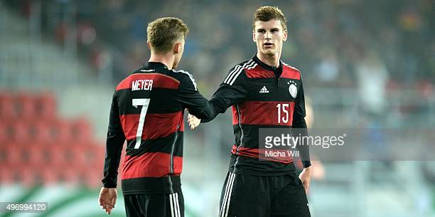 Timo Werner of Germany high fives with Max Meyer of Germany after scoring his teams first goal during the 2017 UEFA European U21 Championships...