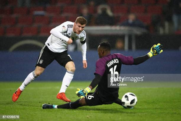 Timo Werner of Germany scores his sides first goal past Steve Mandanda of France during the international friendly match between Germany and France...