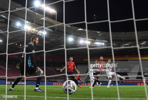 Timo Werner of Germany scores his team's first goal past David De Gea of Spain during the UEFA Nations League group stage match between Germany and...