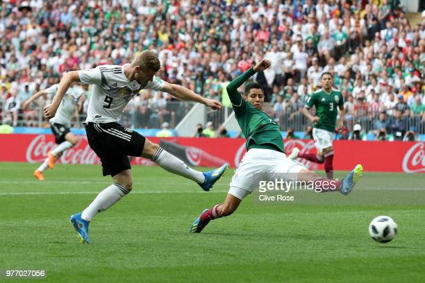 Timo Werner of Germany shoots past Hugo Ayala of Mexico during the 2018 FIFA World Cup Russia group F match between Germany and Mexico at Luzhniki...