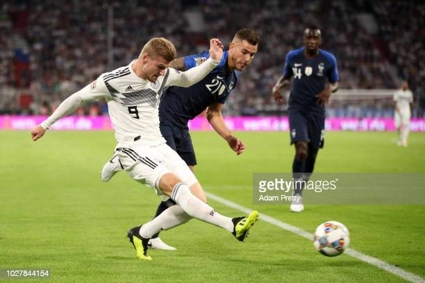 Timo Werner of Germany shoots under pressure from Lucas Hernandez of France during the UEFA Nations League Group A match between Germany and France...