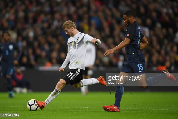 Timo Werner of Germany shoots while under pressure from Joe Gomez of England during the International friendly match between England and Germany at...