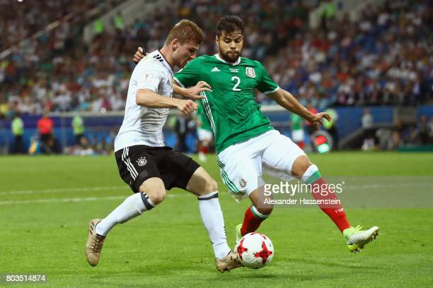 Timo Werner of Germany takes on Nestor Araujo of Mexico during the FIFA Confederations Cup Russia 2017 SemiFinal between Germany and Mexico at Fisht...